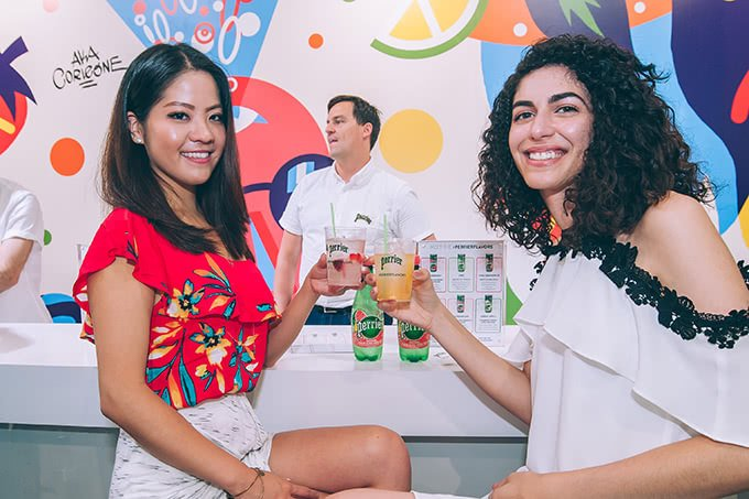 Attendees at the Perrier Flavor Studio popup holding drinks