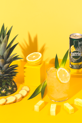 lemon ginger fizz mocktail with perrier lemon sparkling water and pineapple juice drink recipe