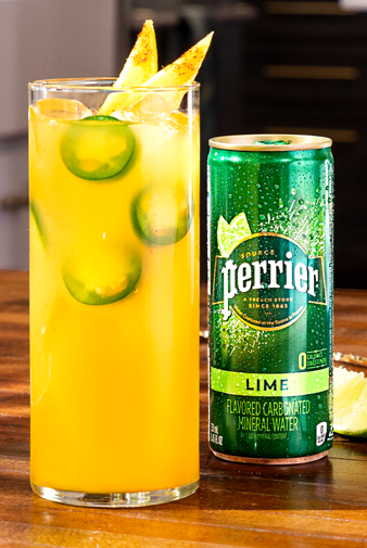 close-up of can of lime perrier with glass of bright and bold mocktail