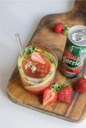 can of perrier strawberry flavor with a glass of strawberry watermelon cocktail